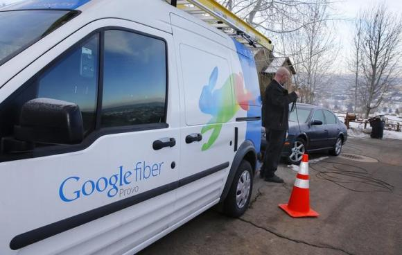 A technician gets cabling out of his truck to install Google Fiber in a residential home in Provo